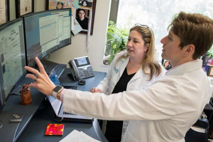 doctors pointing at a computer