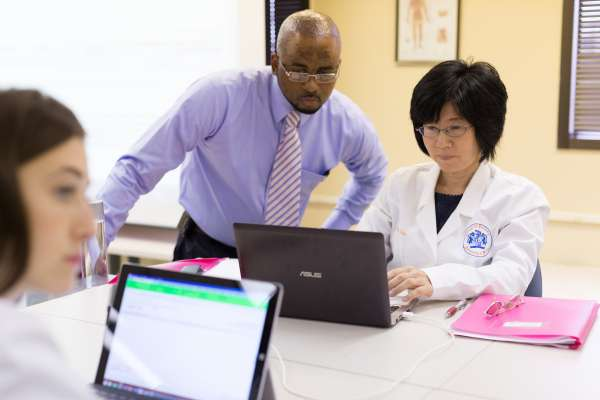 man looking at work on computer
